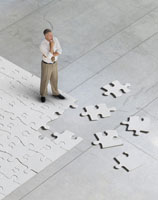 man standing on jigsaw puzzle