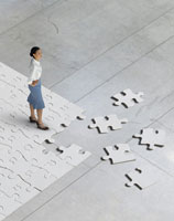 woman standing on jigsaw puzzle