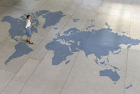 woman standing on world map