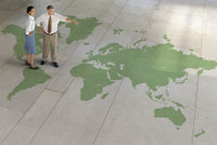 people standing on world map