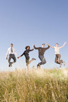 people jumping in field