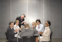 people laughing in a meeting