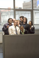 people crammed into tiny cubicle