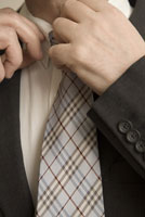 man tying his tie
