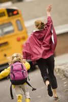 Mother and daughter running for bus
