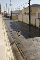 Man jogging on urban street