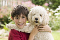 boy smiling with dog