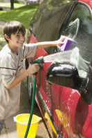 boy washing the car