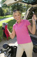 Woman unloading golf clubs from car
