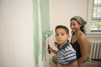 Mother and son painting together