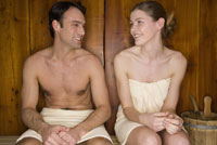 Couple sitting in sauna together