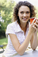 Woman holding drink smiling