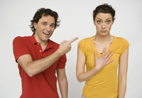 Man pointing at surprised woman