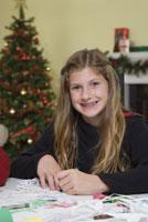 Teenage girl making Christmas snowflakes
