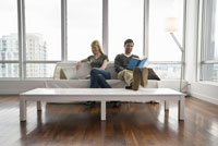Couple relaxing in living room