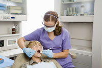 dentist examining boy