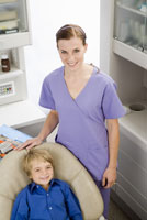 dentist and boy in dentists office