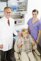 Boy with dentists in office