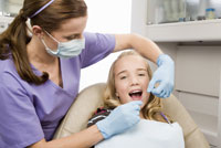 dentist examining girl