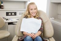 Girl sitting in dental chair