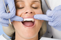 Woman being examined by dentist