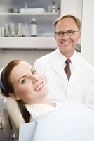 Male dentist and woman