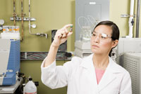 scientist examining vial
