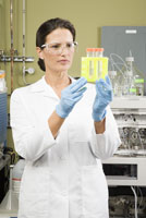 scientist examining vials
