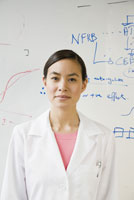 scientist in front of white board