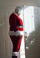 Santa claus looking out door