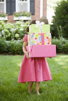 Girl holding stack of gifts
