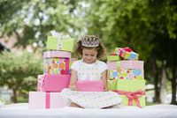 Girl with stacks of gifts