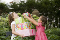 Girl carrying stack of gifts