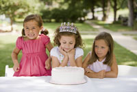 Girl looking at birthday cake