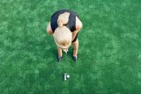 woman playing golf 11029014733| 写真素材・ストックフォト・画像・イラスト素材|アマナイメージズ