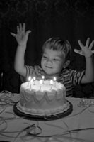 boy and birthday cake