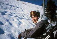 Skier riding ski lift 11029014969| 写真素材・ストックフォト・画像・イラスト素材|アマナイメージズ