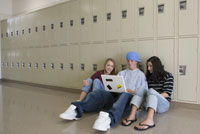 Three teenagers in school hallway