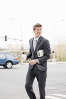 Businessman walking across street
