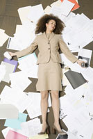 woman laying on pile of paperwork