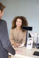 businesswoman assisting customer