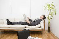 Businessman laying on sofa