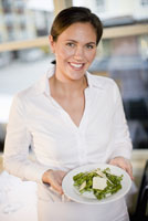 Waitress holding plate of food 11029015458| 写真素材・ストックフォト・画像・イラスト素材|アマナイメージズ
