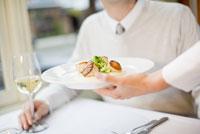 Man being served at restaurant