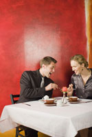 Couple eating at restaurant