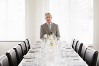 businessman sitting at head of table