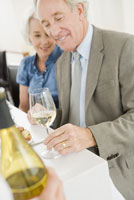 couple looking at wine glass