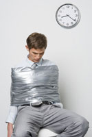 Businessman wrapped in duct tape