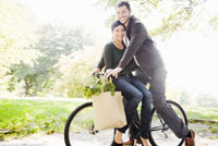 couple riding same bicycle