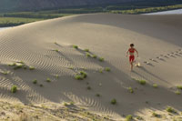 Woman running along sand dune